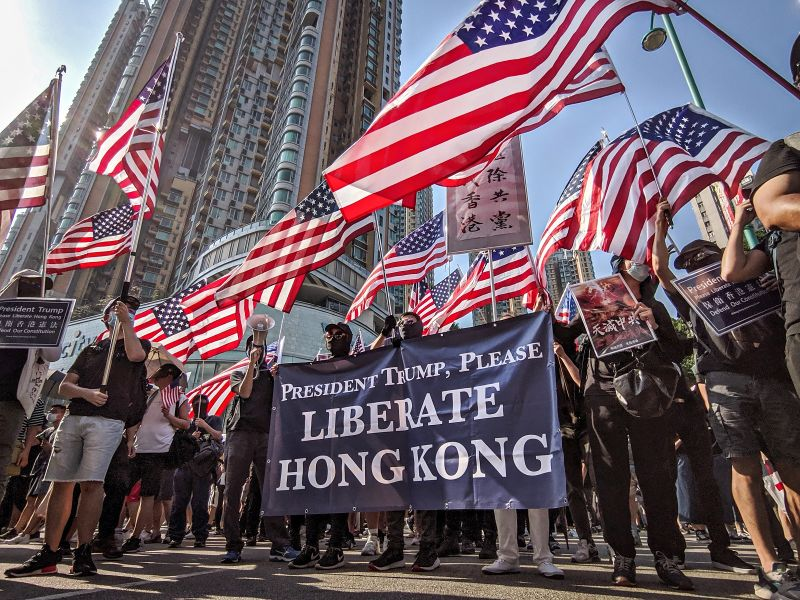 Protesters in Hong Kong hold a banner reading 'President Trump, please liberate Hong Kong