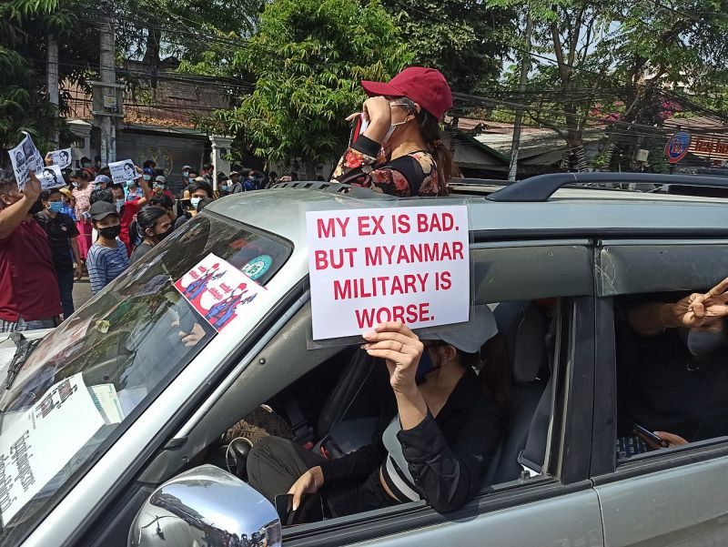 Protesters hold placard that reads 'my ex is bad. but Myanmar military is worse