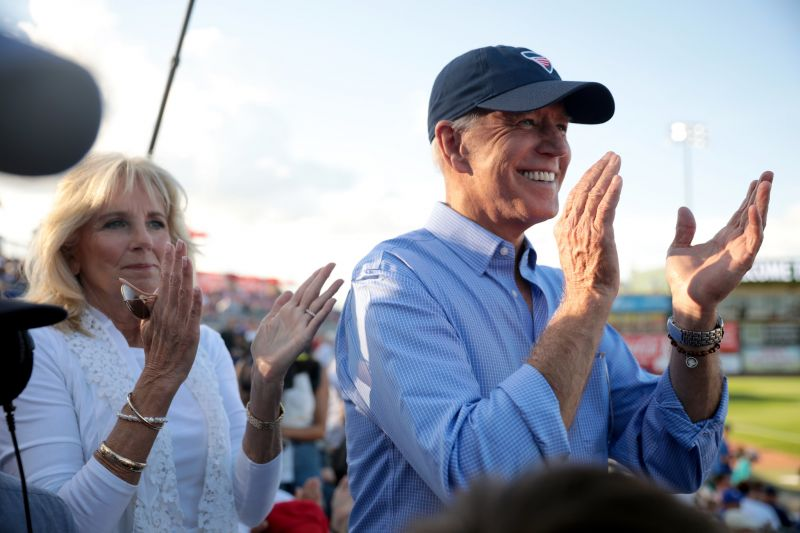 Joe Biden (right) and his wife Jill attend an event at a baseball stadium.