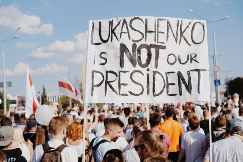 Protest banner reads Lukashenko is not our president