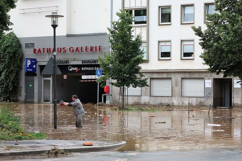 A man stands in floodwaters in the city of Hagen