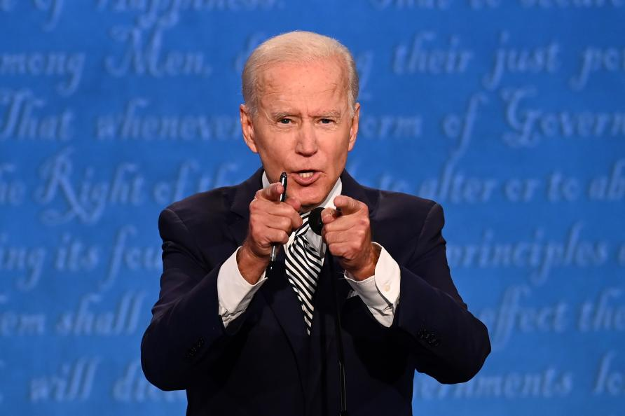 Joe Biden points at the camera as he speaks during the first presidential debate