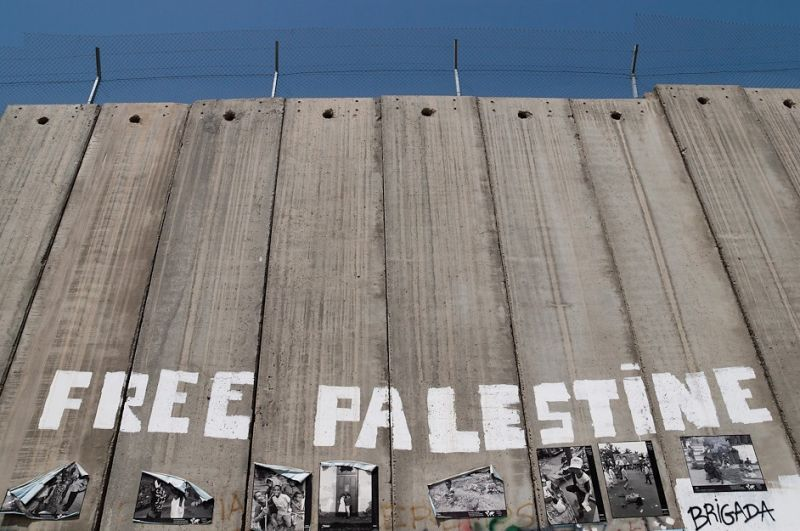 A wall in the West Bank reads 'free Palestine