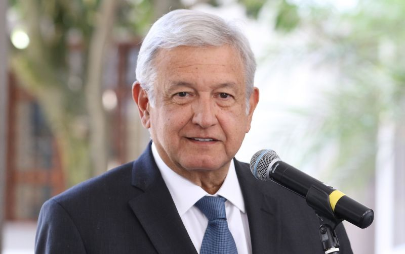 Mexican President Obrador speaks into a microphone